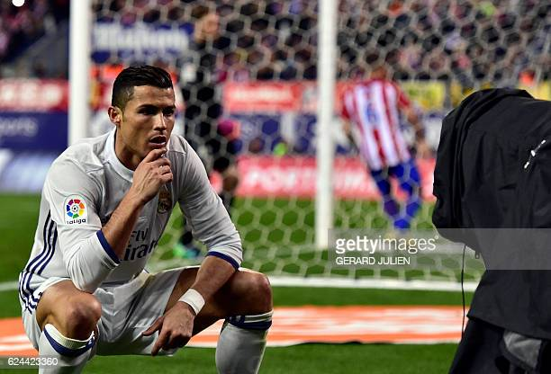 TOPSHOT Real Madrid's Portuguese forward Cristiano Ronaldo poses in front of a TV camera as he celebrates after scoring during the Spanish league...