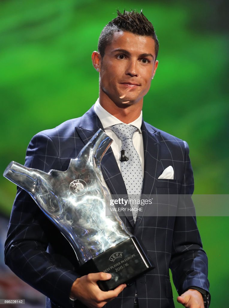 Real Madrid's Portuguese forward Cristiano Ronaldo poses with his trophy of Best Men's player in Europe at the end of the UEFA Champions League Group...