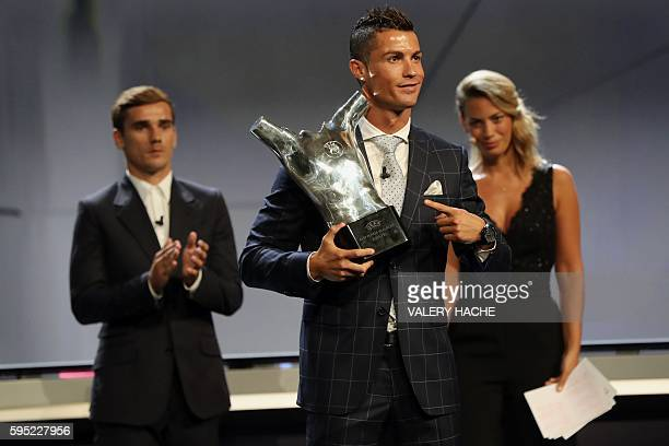 Real Madrid's Portuguese forward Cristiano Ronaldo poses with his trophy of Best Men's player in Europe next to Atletico Madrid's French forward...