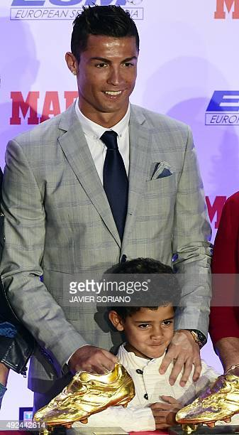 Real Madrid's Portuguese forward Cristiano Ronaldo poses with his son Cristiano Ronaldo Jr after receiving his fourth European Golden Shoe on October...