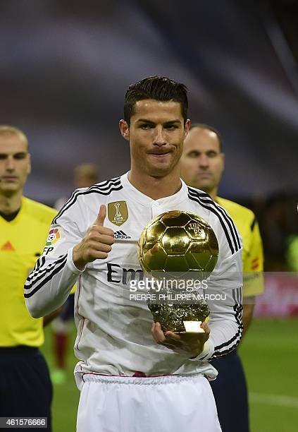 Real Madrid's Portuguese forward Cristiano Ronaldo poses with the 2014 FIFA Ballon d'Or award for player of the year prior to the Spanish Copa del...