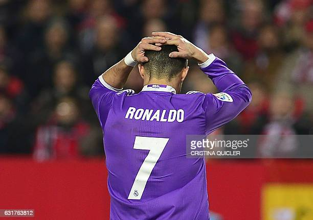 TOPSHOT Real Madrid's Portuguese forward Cristiano Ronaldo reacts after missing a goal opportunity during the Spanish league football match Sevilla...