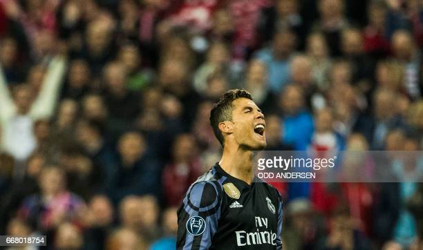 Real Madrid's Portuguese forward Cristiano Ronaldo reacts after putting a free kick wide during the UEFA Champions League 1st leg quarterfinal...