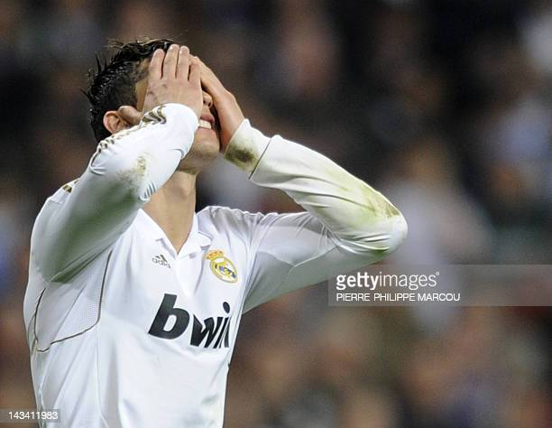 Real Madrid's Portuguese forward Cristiano Ronaldo reacts after missing his penalty during the penalty shoot out at the UEFA Champions League second...
