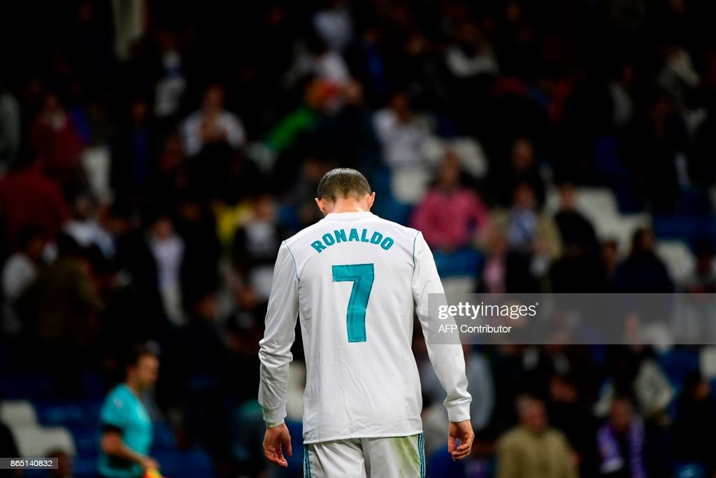 Real Madrid's Portuguese forward Cristiano Ronaldo reacts at the end of the Spanish league football match Real Madrid CF vs SD Eibar at the Santiago Bernabeu stadium in Madrid on October 22, 2017. /