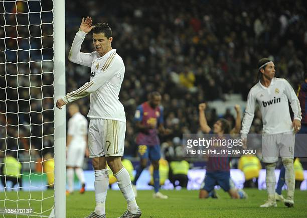Real Madrid's Portuguese forward Cristiano Ronaldo reacts during the 'El clasico' Spanish League football match Real Madrid against Barcelona at the...