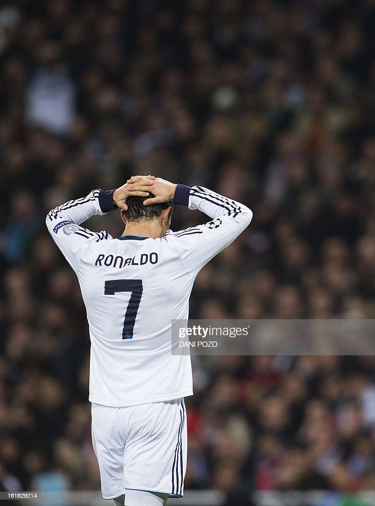 Real Madrid's Portuguese forward Cristiano Ronaldo reacts during the UEFA Champions League round of 16 first leg football match Real Madrid CF vs Manchester United FC at the Santiago Bernabeu stadium in Madrid on February 13, 2013. The match ended in a 1-1 draw.
