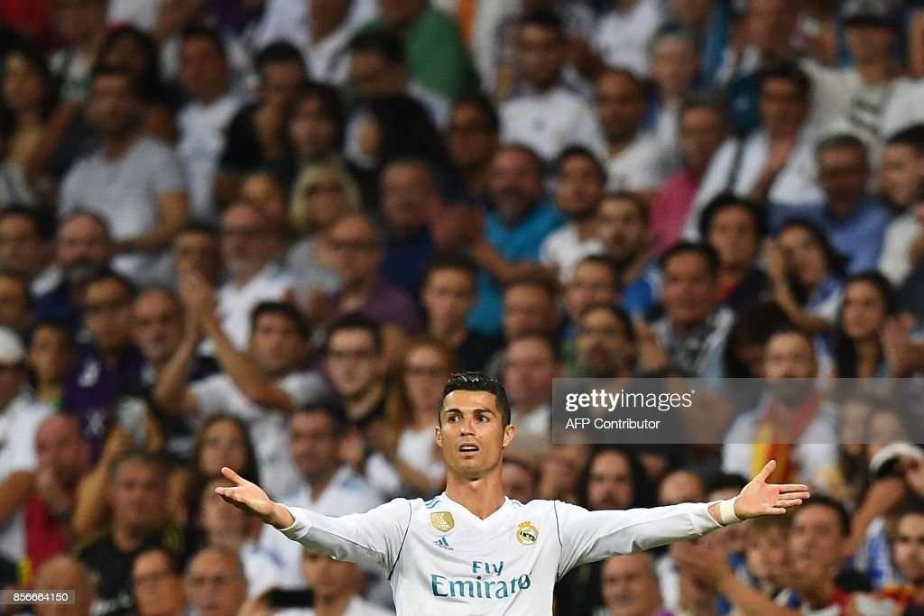 Real Madrid's Portuguese forward Cristiano Ronaldo reacts during the Spanish league football match Real Madrid CF vs Espanyol at the Santiago Bernabeu stadium in Madrid on October 1, 2017. /