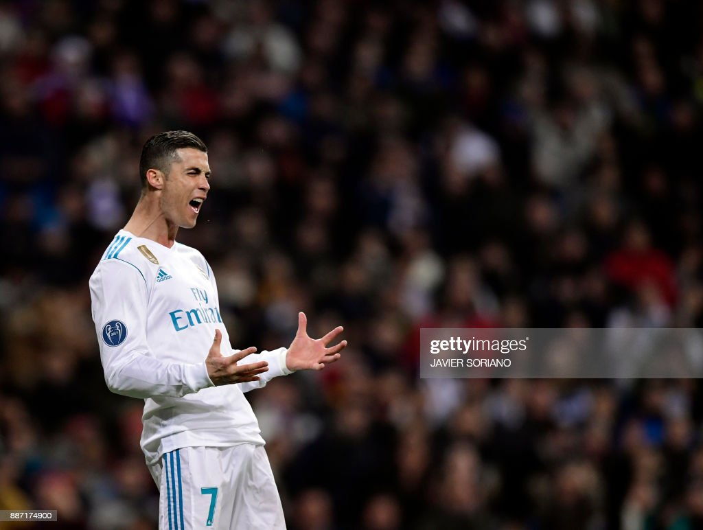 Real Madrid's Portuguese forward Cristiano Ronaldo reacts to missing a goal during the UEFA Champions League group H football match Real Madrid CF vs Borussia Dortmund at the Santiago Bernabeu stadium in Madrid on December 6, 2017. /