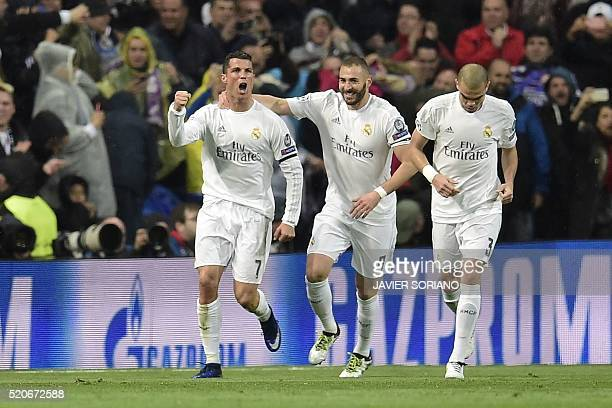 Real Madrid's Portuguese forward Cristiano Ronaldo Real Madrid's French forward Karim Benzema aqnd Real Madrid's Portuguese defender Pepe celebrate...