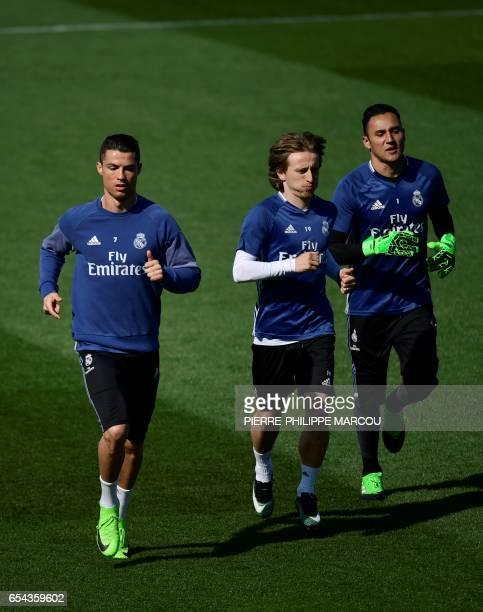 Real Madrid's Portuguese forward Cristiano Ronaldo Real Madrid's Croatian midfielder Luka Modric and Real Madrid's Costa Rican goalkeeper Keylor...