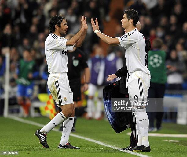 Real Madrid's Portuguese forward Cristiano Ronaldo replaces Real Madrid's captain Raul Gonzalez during a Champions league group C football match at...
