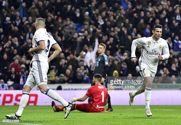 Real Madrid's Portuguese forward Cristiano Ronaldo runs after scoring a goal during the Spanish league football match Real Madrid CF vs Real Sociedad...