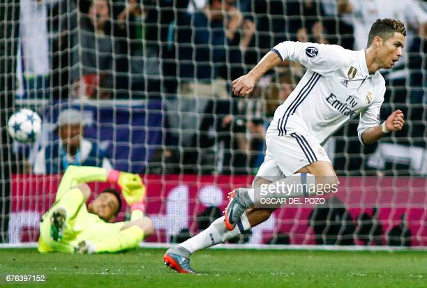 TOPSHOT Real Madrid's Portuguese forward Cristiano Ronaldo runs after scoring a goal during the UEFA Champions League semifinal first leg football...