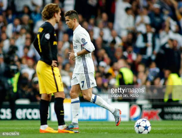 Real Madrid's Portuguese forward Cristiano Ronaldo runs past Atletico Madrid's French forward Antoine Griezmann during the UEFA Champions League...