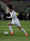 Real Madrid's Portuguese forward Cristiano Ronaldo runs with the ball during their UEFA Champions League first leg quarterfinal football match...