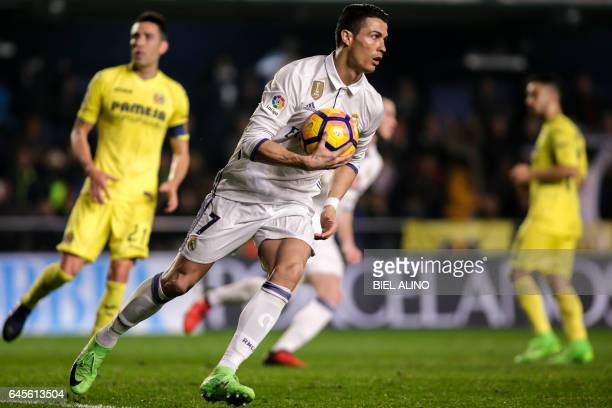 TOPSHOT Real Madrid's Portuguese forward Cristiano Ronaldo runs with the ball after scoring a goal during the Spanish League football match...
