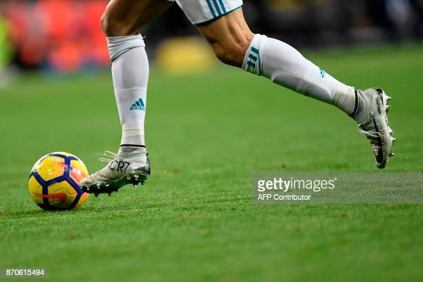 Real Madrid's Portuguese forward Cristiano Ronaldo runs with the ball during the Spanish league football match Real Madrid CF vs UD Las Palmas at the...