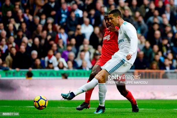 Real Madrid's Portuguese forward Cristiano Ronaldo scores a goal past Sevilla's French defender Lionel Carole during the Spanish league football...