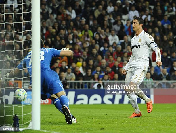 Real Madrid's Portuguese forward Cristiano Ronaldo scores during the UEFA Champions League second leg quarterfinal football match Real Madrid against...
