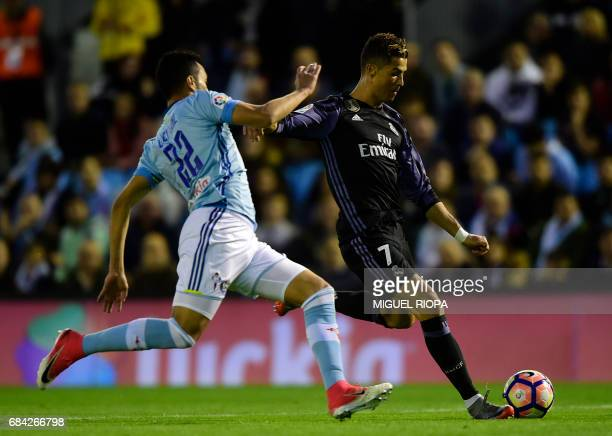 Real Madrid's Portuguese forward Cristiano Ronaldo scores his second goal during the Spanish league football match RC Celta de Vigo vs Real Madrid CF...