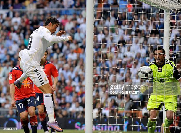 Real Madrid's Portuguese forward Cristiano Ronaldo scores his team's third goal against Osasuna during the Spanish league football match Real Madrid...