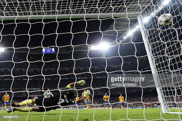 Real Madrid's Portuguese forward Cristiano Ronaldo shoots a penalty kick to score past Juventus' goalkeeper Gianluigi Buffon during the UEFA...