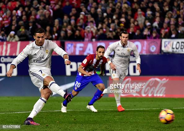 Real Madrid's Portuguese forward Cristiano Ronaldo shoots a penalty kick to score a goal during the Spanish league football match between Club...