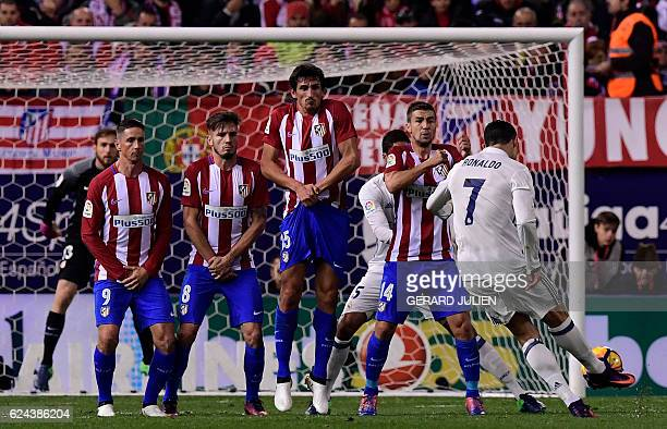 TOPSHOT Real Madrid's Portuguese forward Cristiano Ronaldo shoots to score a goal during the Spanish league football match between Club Atletico de...