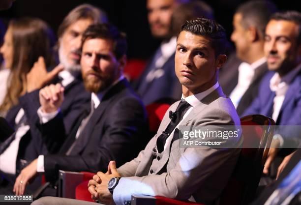 Real Madrid's Portuguese forward Cristiano Ronaldo sits alongside Barcelona's Argentinian forward Lionel Messi as they wait ahead of the awarding of...