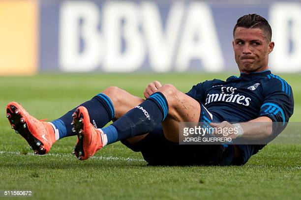 Real Madrid's Portuguese forward Cristiano Ronaldo sits on the field during the Spanish league football match Malaga CF vs Real Madrid CF at La...