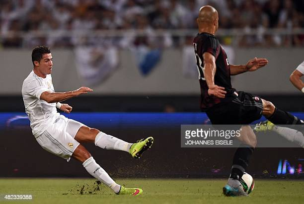 Real Madrid's Portuguese forward Cristiano Ronaldo slips on the grass during the International Champions Cup football match between AC Milan and Real...