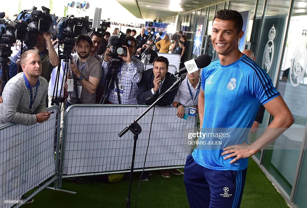 Real Madrid's Portuguese forward Cristiano Ronaldo smiles as he addresses journalists during the club's Open Media Day at Real Madrid sport city in Madrid on May 24, 2016. / AFP / GERARD