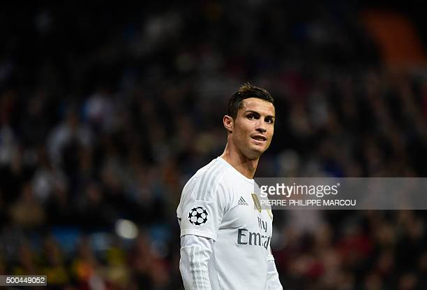 Real Madrid's Portuguese forward Cristiano Ronaldo smiles during the UEFA Champions League Group A football match Real Madrid CF vs Malmo FF at the...