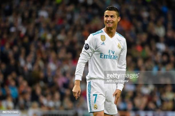 Real Madrid's Portuguese forward Cristiano Ronaldo smiles during the UEFA Champions League group H football match Real Madrid CF vs Tottenham Hotspur...