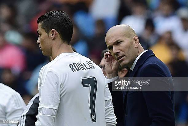 Real Madrid's Portuguese forward Cristiano Ronaldo speaks with Real Madrid's French coach Zinedine Zidane during the Spanish league football match...