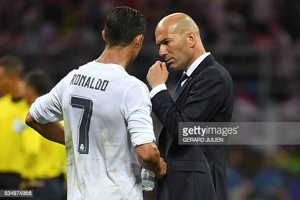 Real Madrid's Portuguese forward Cristiano Ronaldo speaks with Real Madrid's French coach Zinedine Zidane before the penalty shootout during the UEFA...