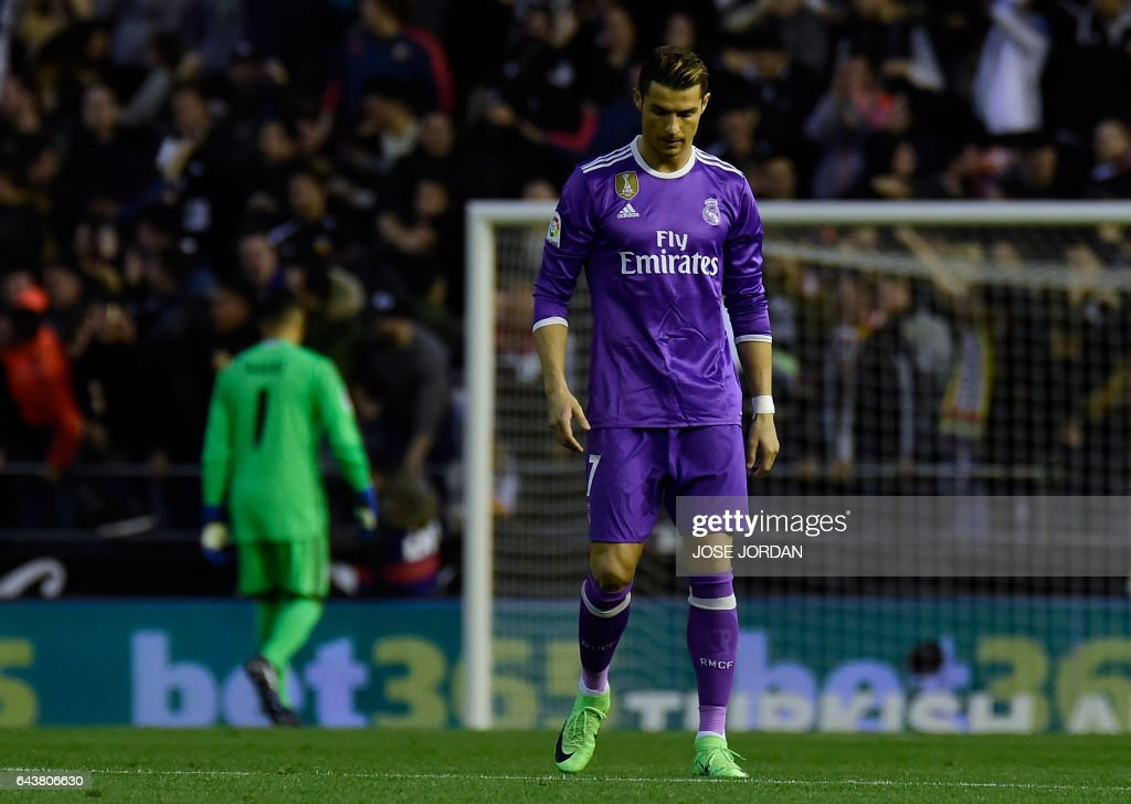 TOPSHOT - Real Madrid's Portuguese forward Cristiano Ronaldo stands after a goal by Valencia during the Spanish league football match Valencia CF vs Real Madrid CF at the Mestalla stadium in Valencia on February 22, 2017. /