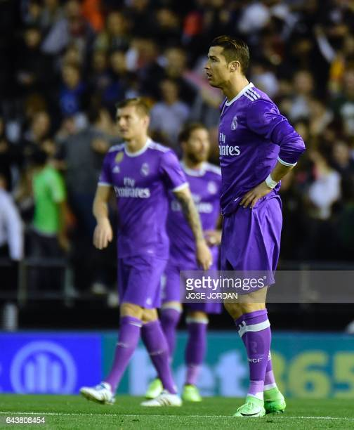 Real Madrid's Portuguese forward Cristiano Ronaldo stands after Valencia's second goal during the Spanish league football match Valencia CF vs Real...