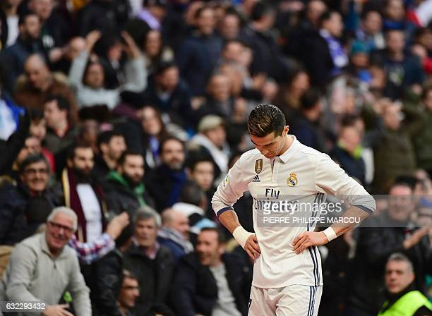 Real Madrid's Portuguese forward Cristiano Ronaldo stands during the Spanish league football match Real Madrid CF vs Malaga CF at the Santiago...