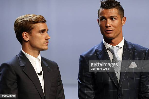 Real Madrid's Portuguese forward Cristiano Ronaldo stands next to Atletico Madrid's French forward Antoine Griezmann at the end of the UEFA Champions...