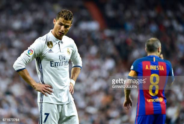 TOPSHOT Real Madrid's Portuguese forward Cristiano Ronaldo stands on the field during the Spanish league football match Real Madrid CF vs FC...