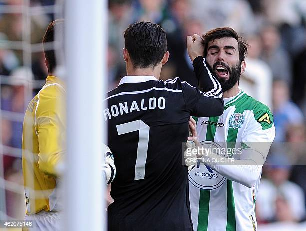 Real Madrid's Portuguese forward Cristiano Ronaldo strikes Cordoba's defender Jose Angel Crespo during the Spanish league football match Cordoba CF...