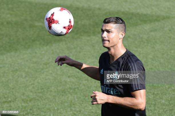 Real Madrid's Portuguese forward Cristiano Ronaldo takes part in a training session at Real Madrid sport city in Madrid on August 15 on the eve of...