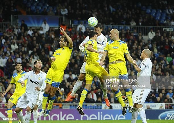 Real Madrid's Portuguese forward Cristiano Ronaldo vies with Apoel's Brazilian midfielder Kaka and Apoel's Portuguese defender Paulo Jorge during the...