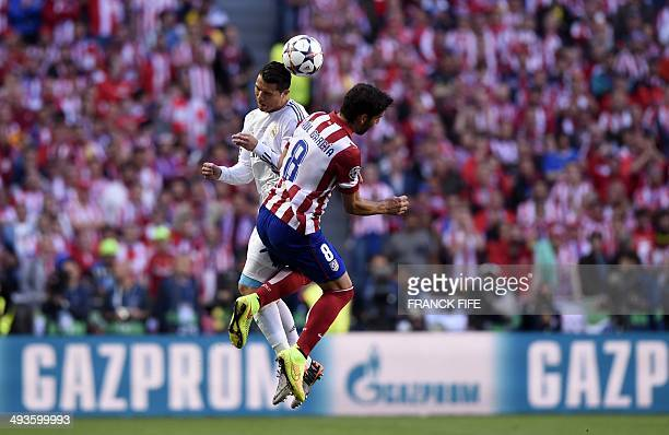 Real Madrid's Portuguese forward Cristiano Ronaldo vies with Atletico Madrid's midfielder Raul Garcia during the UEFA Champions League Final Real...