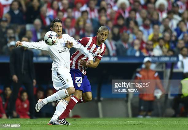 Real Madrid's Portuguese forward Cristiano Ronaldo vies with Atletico Madrid's Brazilian defender Joa Miranda de Souza during the UEFA Champions...