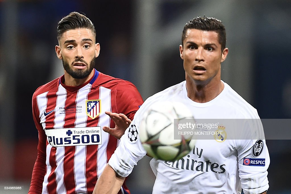 Real Madrid's Portuguese forward Cristiano Ronaldo (R) vies with Atletico Madrid's Belgian forward Yannick Ferreira Carrasco during the UEFA Champions League final football match between Real Madrid and Atletico Madrid at San Siro Stadium in Milan, on May 28, 2016. / AFP / FILIPPO