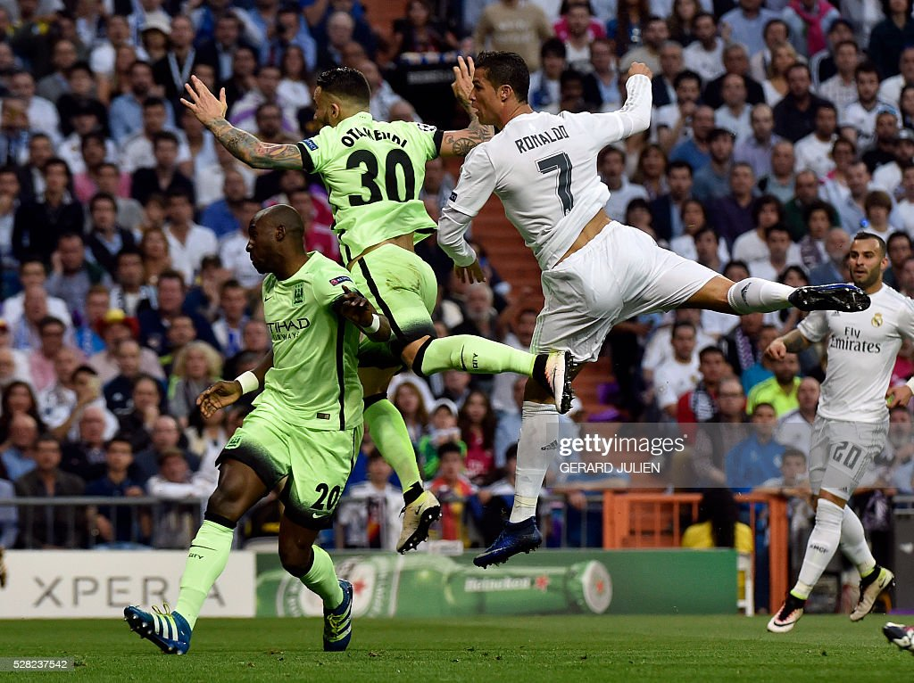 Real Madrid's Portuguese forward Cristiano Ronaldo (R) vies with Manchester City's Argentinian defender Nicolas Otamendi (C) and Manchester City's French defender Eliaquim Mangala during the UEFA Champions League semi-final second leg football match Real Madrid CF vs Manchester City FC at the Santiago Bernabeu stadium in Madrid, on May 4, 2016. / AFP / GERARD