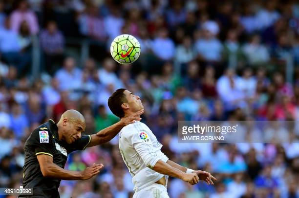 Real Madrid's Portuguese forward Cristiano Ronaldo vies with Granada's Brazilian defender Doria during the Spanish league football match Real Madrid...